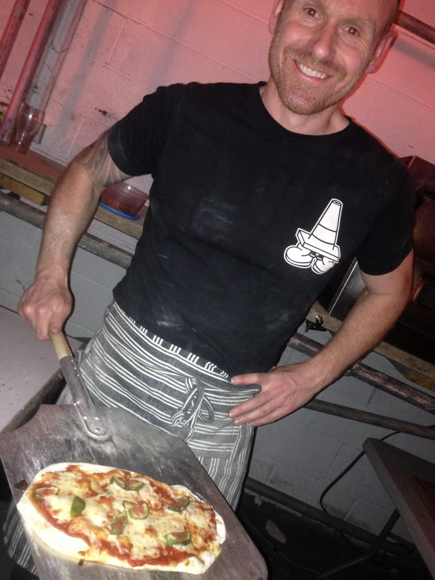 Kev with his freshly cooked pizza!